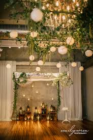 wedding backdrop canopy vine and branch canopy hanging candles floating chuppah front