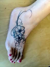 37 hibiscus flowers tattoos on foot