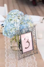 hydrangea centerpiece low blue hydrangea centerpiece and table number