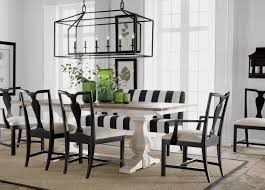 lighting white dining table with dark wood dining chairs on sisal