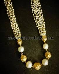 pearls and gold set jewellery designs