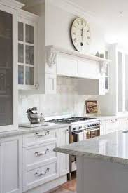 image result for black and white kitchen designs with mantle