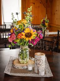 country centerpieces we these country wildflower centerpieces featuring sunflowers