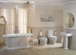 mini crystal chandelier over white oval soaking bathtub and