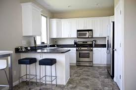 travertine countertops white kitchen black lighting flooring