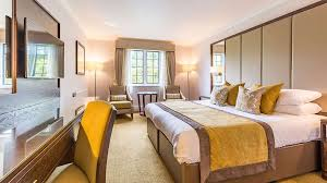 bedroom at rhinefield house hotel in hampshire