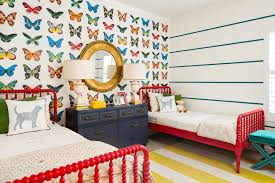interiors kids room with colorful butterfly wallpaper by the