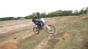 how to wheelie a motocross bike novice crashes dirt bike into parked car jukin media