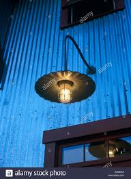 detail of contemporary country style outdoor light above entrance