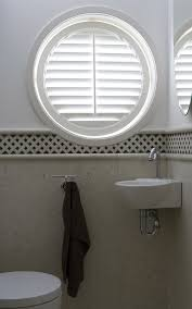 circular windows can be covered with cellular shades or shutters
