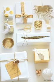 gift wrapping in white and gold wraps gold and gift