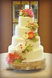 wedding cake flower white wedding cake with cascading fresh flowers white wedding