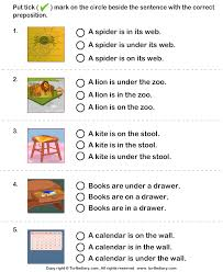 choose the sentence with the correct preposition in on and under