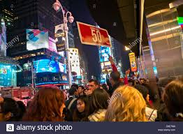 november 22 2012 new york ny a in the crowd points to a