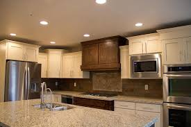 maple cabinets with black island lighting light pine cabinet with downlight olive green wall