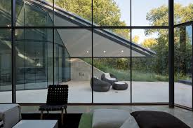 interior glass walls for homes edgeland house built into a hill by bercy chen studio homeli