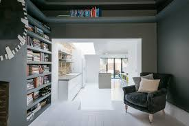a chic grey and white kitchen and living space