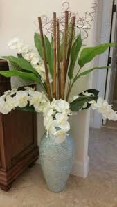 Turquoise Glass Vase Floral Arrangement With Orchids In A Turquoise Glass Vase Using