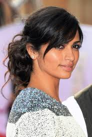 pic of black women side swept bangs and bun hairstyle pictures of camila alves easy black updo with side swept bangs for