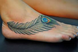 20 peacock feather tattoos and the beautiful meanings behind them