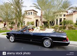 bentley black convertible black convertible car parked in front f luxury house stock photo