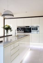 Modern White Kitchen Cabinets Photos Sleek Lines With This White Gloss Handleless Kitchen And Silestone