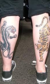 tiger and panther on legs tattooimages biz leg tattoos