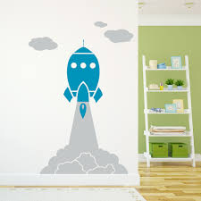 rocket launch through clouds wall decal
