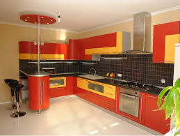red and yellow cabinetry with kitchen hoods also black ceramic