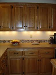 oak kitchen cabinets hardware what type of finish on knobs handles lights in oak kitchen