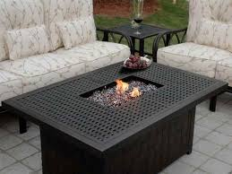 patio ideas propane fire pit coffe table with cream cushion patio