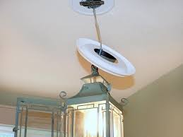 changing recessed light to chandelier classy replace recessed light with a pendant fixture hgtv convert