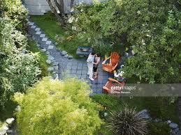 couple dancing in backyard garden overhead view stock photo