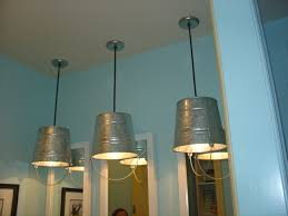 fun bucket light fixtures in kids bathroom of parade of home house