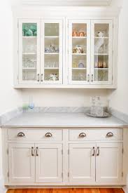 butlers pantry built with painted white inset shaker cabinets