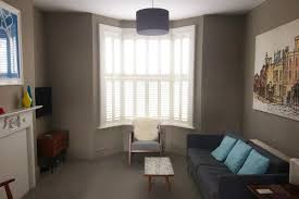 classic shutters for a modern west ham living room plantation