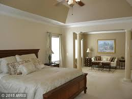 traditional master bedroom with high ceiling u0026 flush light in