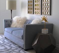 Arabesque Rugs Gray Velvet Tufted Sofa With White Mongolian Pillows