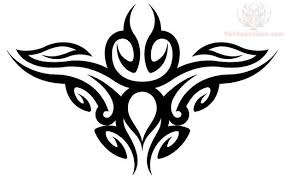 tribal cross tattoo on girls lower back tribal fire tattoos for
