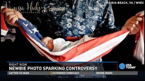 Holding The Flag Photo Of Baby In American Flag Shrouded In Controversy