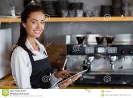 blue martini waitress portrait of smiling waitress using digital tablet stock photo