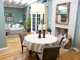 this living and dining room combo features cool blue green walls