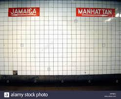New York Train Station Map by White Ceramic Tiled Wall In A New York City Subway Train Station