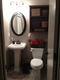 bathrooms dark bathroom with white pedestal sink and oval wall