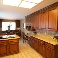Kitchen Cabinet Refinishing Ideas by Furniture Brown Kitchen Cabinet Refacing With Black Countertop