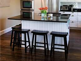 Small Portable Kitchen Island island with frig cabinet in back lower cabinets installed below