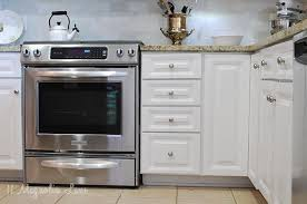 photos of painted cabinets how to paint your kitchen cabinets for a smooth painted finish 11