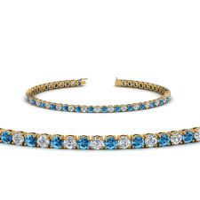 blue diamond bracelet images Tennis diamond bracelet with blue topaz 4 carat in 18k yellow jpg