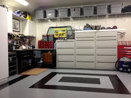 small garage organization with metal cabinet mounted pegboard