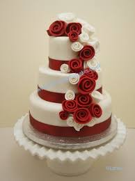 three tier wedding cake with cascading roses three tier rose